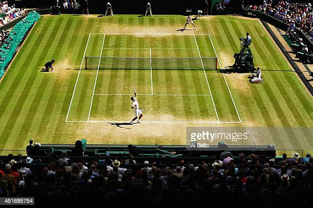 A general view of centre court as Novak Djokovic of Serbia serves during his Gentlemen's Singles semifinal match against Grigor Dimitrov of Bulgaria...