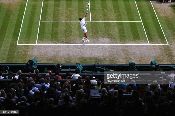 General view of centre court as Novak Djokovic of Serbia serves during the Gentlemen's Singles Final match against Roger Federer of Switzerland on...
