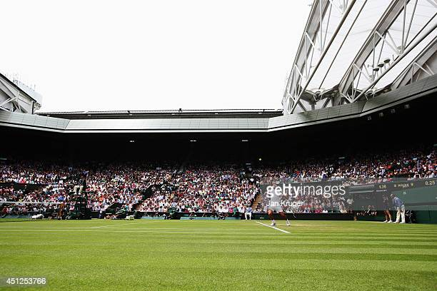 A general view of centre court as Rafael Nadal of Spain serves during his Gentlemen's Singles second round match against Lukas Rosol of Czech...