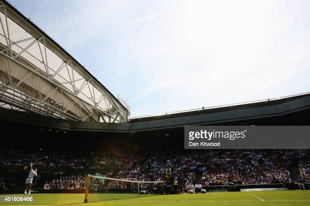 General view of centre court as Roger Federer of Switzerland serves during his Gentlemen's Singles quarterfinal match against Stan Wawrinka of...
