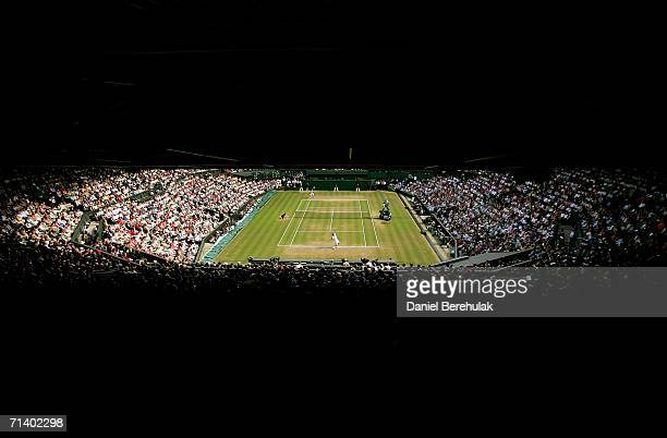 A general view of centre court as Roger Federer of Switzerland serves to Rafael Nadal of Spain during the men's final on day thirteen of the...