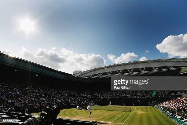 A general view of Centre Court as Roger Federer of Switzerland serves during the men's singles final match against Andy Roddick of USA on Day...