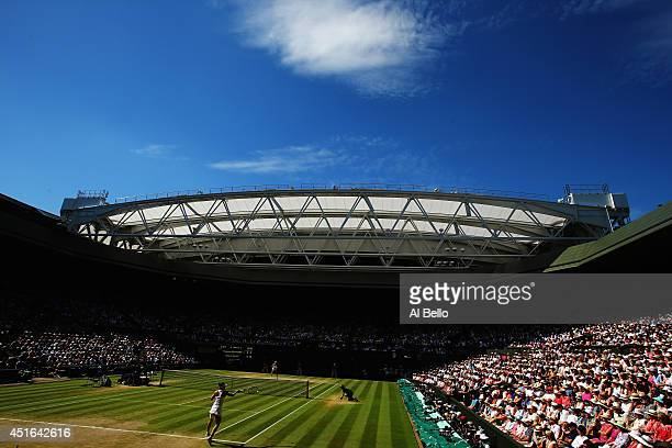 General view of centre court as Simona Halep of Romania plays a forehand return during her Ladies' Singles semifinal match against Eugenie Bouchard...