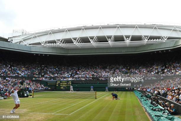 A general view of centre court as Tomas Berdych of The Czech Republic serves during the Gentlemen's Singles semi final match against Roger Federer of...