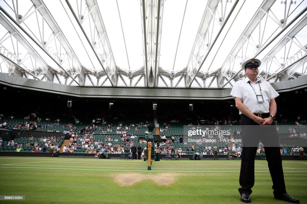 General view of centre court roof closed before the start of Novak Djokovic's and Rafael Nadal's match on day twelve of the Wimbledon Championships at the All England Lawn Tennis and Croquet Club, Wimbledon.