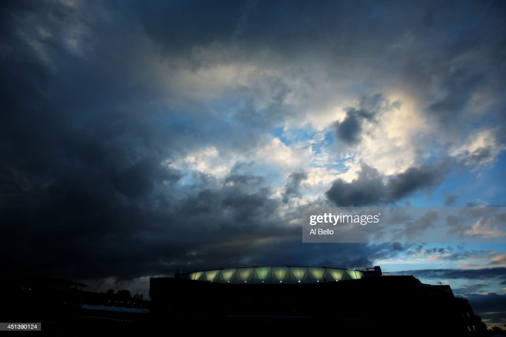 General View of Centre Court under a darkening sky on day six of the Wimbledon Lawn Tennis Championships at the All England Lawn Tennis and Croquet Club at Wimbledon on June 28, 2014 in London, England.