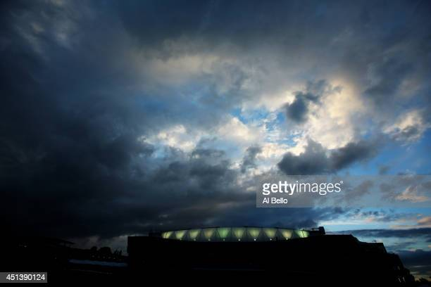 General View of Centre Court under a darkening sky on day six of the Wimbledon Lawn Tennis Championships at the All England Lawn Tennis and Croquet...