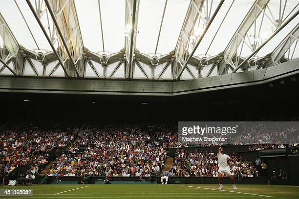 A general view of centre court with the roof closed as Rafael Nadal of Spain serves during his Gentlemen's Singles third round match against Mikhail...