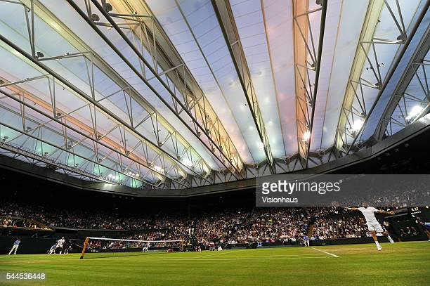 A general view of Centre Court with the roof closed during the match between Roger Federer of Switzerland and Daniel Evans of Great Britain at...