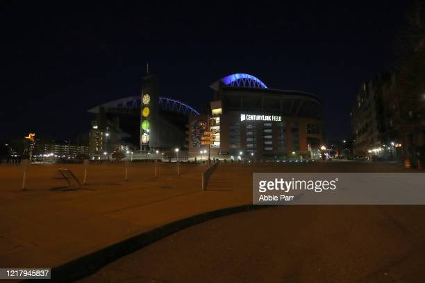 A general view of CenturyLink Field lit up in blue to honor essential workers during the coronavirus outbreak on April 09 2020 in Seattle Washington...