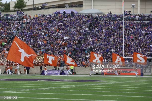 General view of cheerleaders flying Texas flags in the second quarter of a Big 12 matchup between the Texas Longhorns and Kansas State Wildcats on...