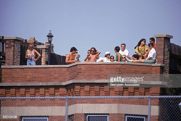 A general view of Chicago Cubs fasn as they watch the game from a rooftop taken during a June1991 season game at Wrigley Field in Chicago Illinois