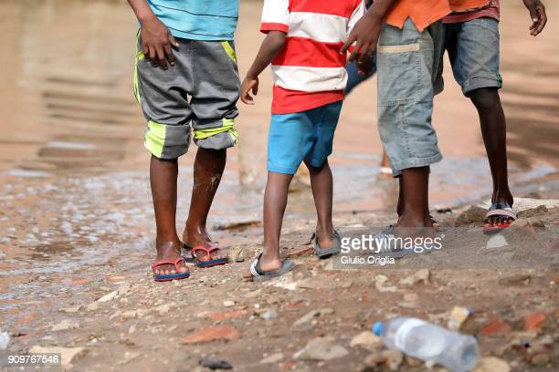 A general view of children at the slum of Mota flooded after heavy rain on January 24 2018 in Luanda Angola Angola has vast mineral and petroleum...