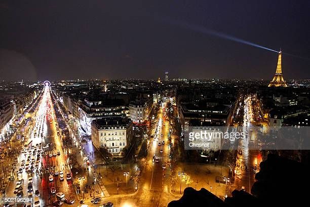 A general view of Christmas illuminations by night on the ChampsElysees and The Eiffel Tower on December 21 2015 in Paris France Parisians and...