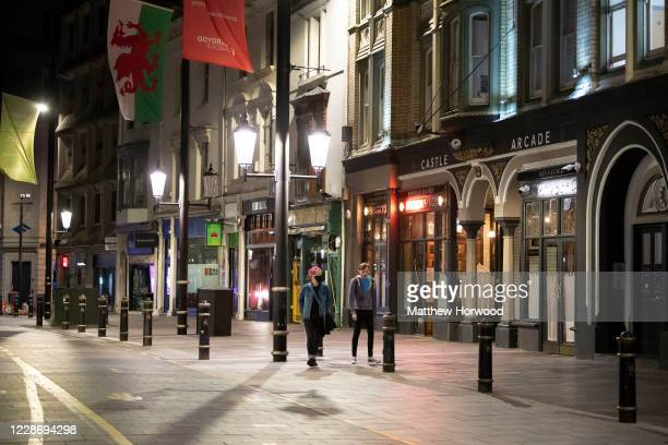 General view of closed bars on St. Mary Street on September 24, 2020 in Cardiff, Wales. Pubs, cafes and restaurants in Wales will have to shut at...
