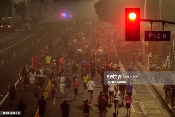 A general view of competitors running before sunrise during the United Airlines Rock 'n' Roll Los Angeles Marathon on October 28 2018 in Los Angeles...