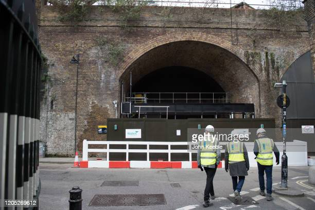 A general view of construction workers by a Railway arch in Winchester Walk being developed by Wates as part of the work on the Borough Yards scheme...