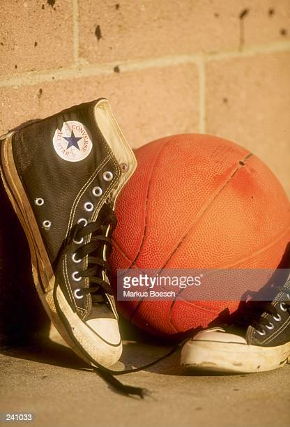 General view of Converse AllStar hitops shoes and a basketball