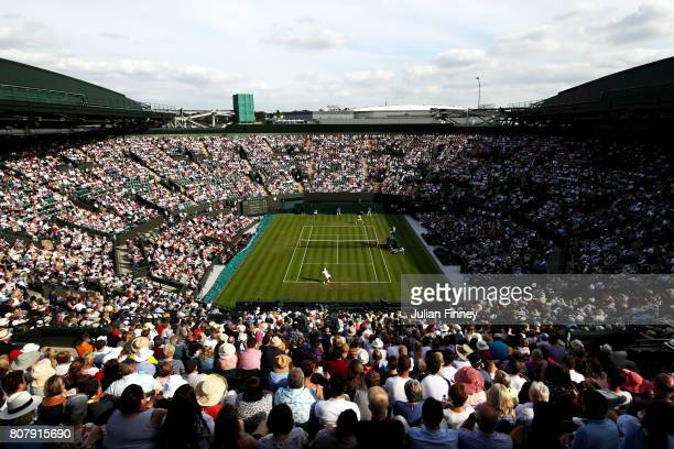 A general view of Court 1 during the Gentlemen's Singles first round match between Dominic Thiem of Austria and Vasek Pospisil of Canada on day two...