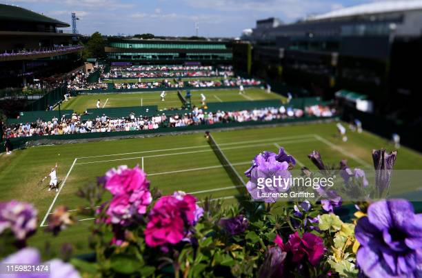 General view of court 14 during the Men's Singles second round match between Ivo Karlovic of Croatia and Thomas Fabbiano of Italy during Day three of...