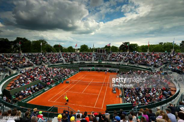 A general view of Court One as Andy Murray of Great Britain serves during his men's singles match against Marinko Matosevic of Australia on day five...
