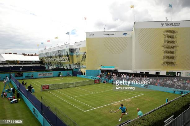 General view of court one as Gilles Simon of France plays a backhand during his Second Round Singles Match against Kevin Anderson of South Africa...