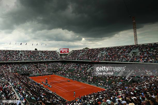 A general view of Court Philippe Chatrier as Rafael Nadal of Spain returns a shot during his men's singles match against dominic thiem of Austria on...