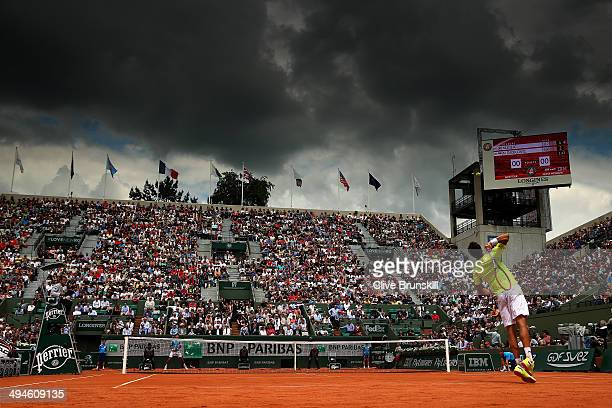 A general view of Court Suzanne Lenglen as Marin Cilic of Croatia serves during his men's singles match against Novak Djokovic of Serbia on day six...