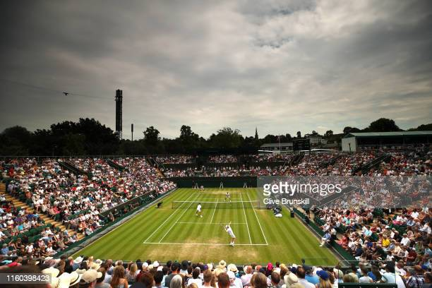 General view of court two as Andy Murray of Great Britain, playing partner of Pierre-Hugues Herbert of France serves in their the Men's Doubles...