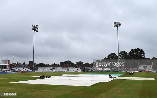 A general view of covers on the pitch as rain delays the start of play during Day One of the Tour Match between England Lions and Australia at The...