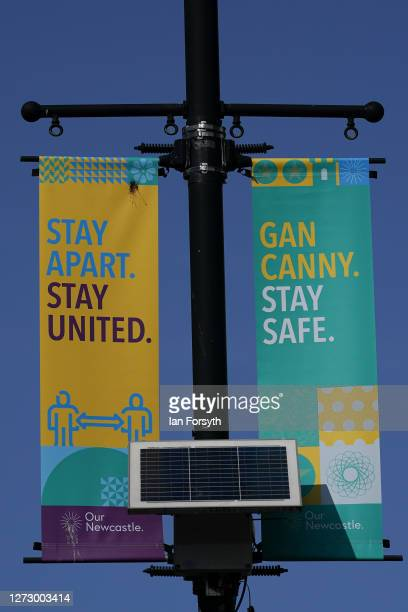 General view of covid19 warning signs hanging from a lamp post in the centre of Newcastle on September 17 2020 in Newcastle upon Tyne England Almost...
