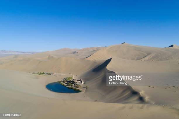 General view of Crescent Lake from the air at Mingsha Shan desert on April 23 2019 in Dunhuang China The Mingsha Shan desert is a part of the ancient...