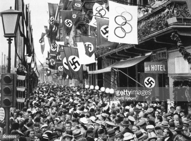 General view of crowd on a street in Berlin as Germany hosts the XI Olympic Games in August of 1936 in Berlin Germany