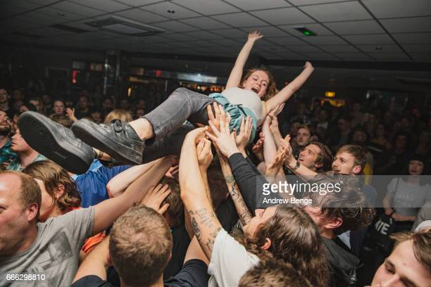 General view of crowd surfers while Pulled Apart By Horses perform at Brudenell Social Club on April 8 2017 in Leeds England