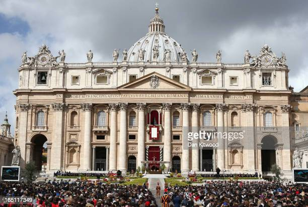 A general view of crowds as Pope Francis appears prior to delivering his first 'Urbi et Orbi' blessing from the balcony of St Peter's Basilica during...