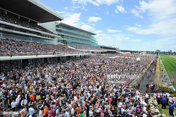 General view of crowds as the field makes its way to the start of Race 7 the Emirates Melbourne Cup on Melbourne Cup Day at Flemington Racecourse on...
