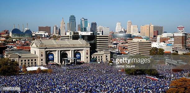 General view of crowds gathered in front of Union Station and the skyline as the Kansas City Royals players hold a rally and celebration following a...