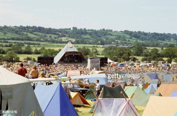 A general view of crowds in front of the original Pyramid stage at Glastonbury Festival in 1983 the campsite can be seen in the foreground