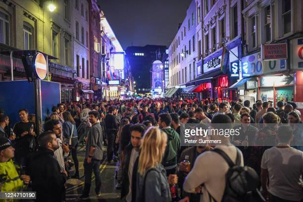 General view of crowds of people in Soho on July 4, 2020 in London, United Kingdom. The UK Government announced that Pubs, Hotels and Restaurants can...
