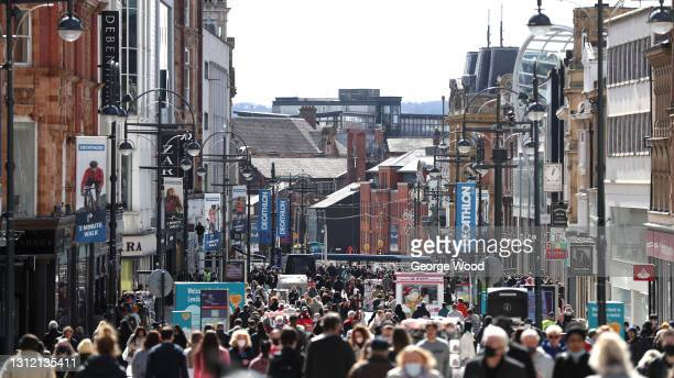 General view of crowds of shoppers on Briggate as non-essential retail reopens on April 12, 2021 in Leeds, United Kingdom. England has taken a...