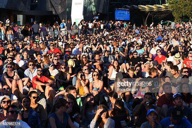A general view of crowds watching the giant screens at Federation Square during Men's Final match between Roger Federer of Switzerland and Rafael...