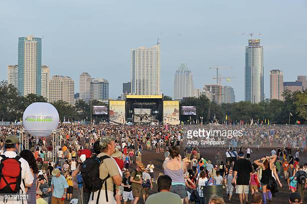 General view of crowds watching the stage on Day 3 of Austin City Limits Festival 2009 with sky scrapers and cranes rising from the centre of the...
