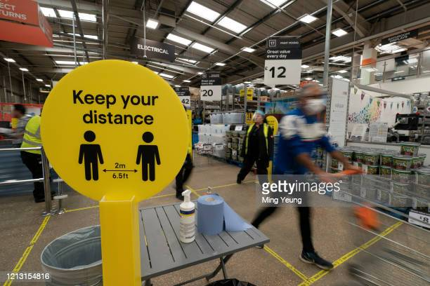 General view of customers practising social distancing after the store adopted safe measures to protect both customers and staff at home improvement...