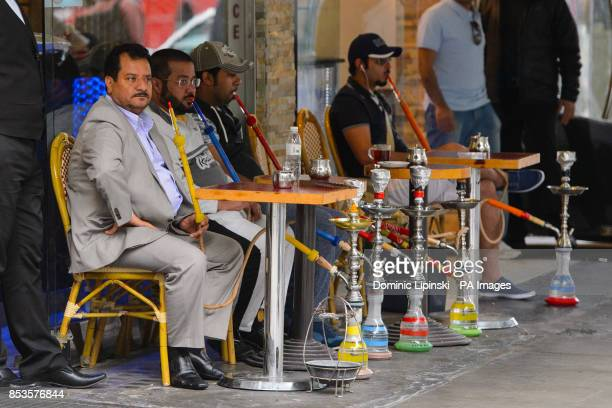 General view of customers smoking shisha pipes outside a cafe on Edgware Road in central London PRESS ASSOCIATION Photo Picture date Monday June 2...