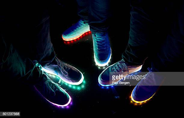 General view of dance music fans with glowing fluorescent soles on their shoes in the audience at Amsterdam Dance Event in Heineken Music Hall...