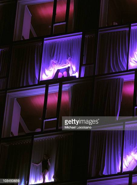 General view of dancers performing in the Standard hotel room windows during the Target Kaleidoscopic Fashion Spectacular exclusive VIP viewing party...
