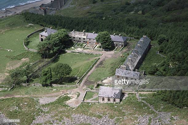 A general view of derelict housing of an abandoned quarrying village Gwynedd Wales June 1983