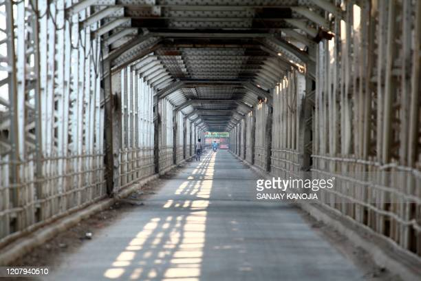 A general view of deserted Old Naini Yamuna bridge is seen during a oneday nationwide Janata curfew imposed as a preventive measure against the...