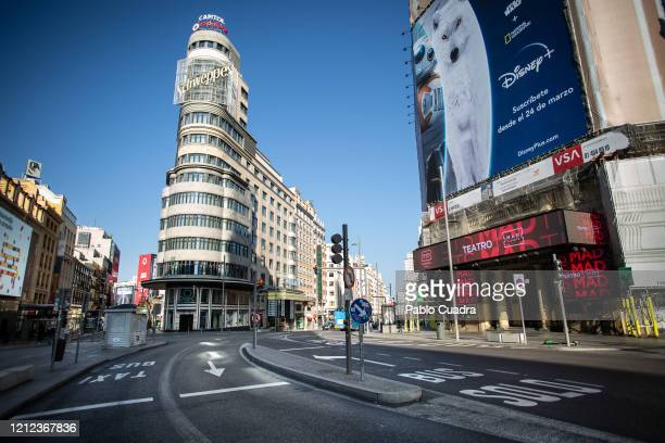 General view of desserted Gran Via street a day after the Government declared the state of alarm in Spain and recommended people to stay at home to...