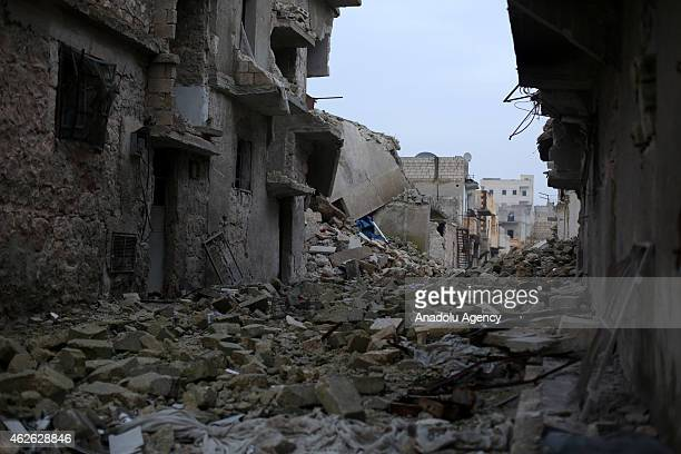 General view of destroyed buildings in Ashrafieh district during the operation staged by 16th division members of Free Syrian Army with howitzers,...